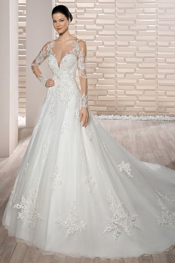 Style 727 	The barely there illusion and lace sleeves and back add contemporary drama to this...