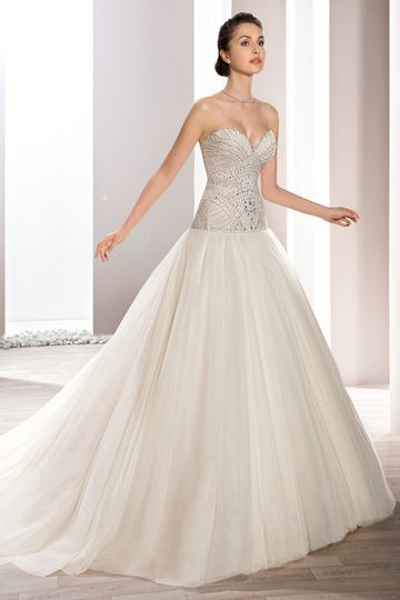 Style 726 Crystals, bugle beads and pearls create a magnificent bodice on this strapless Tulle...