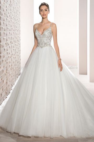 Style 723 Shimmering beaded embroidery and a luxurious Tulle skirt create this stunning Ball...