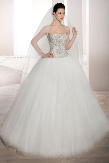 Style 722 This elegant Ball gown features a richly embellished beaded bodice with soft...