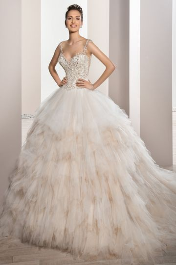 Style721    This stunning Ball gown features a richly bead embellished bodice with Sweetheart...