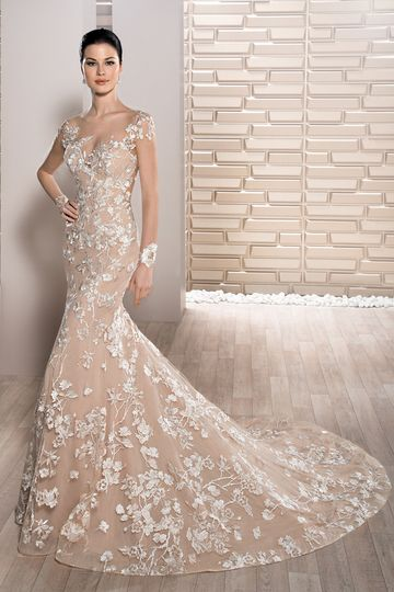 Style 718 Floral embroidery and barely there illusion make a statement in this unique fit n...