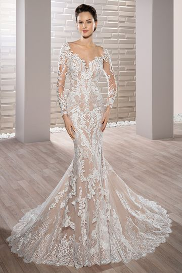 Style 717 Richly embroidered luxurious lace adorns this stunning fit n flare gown with...