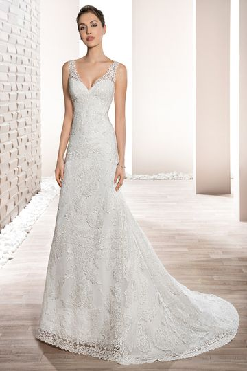 Style 716 Alluring lace adorns this A-line gown with delicate lace straps over a Sweetheart...