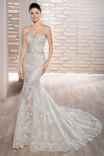 Style 715 This Chic strapless sheath gown features richly embroidered lace with Sweep train...