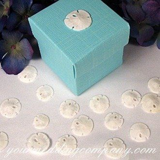Mianiature sand dollars as wedding favor decorations or table confetti.