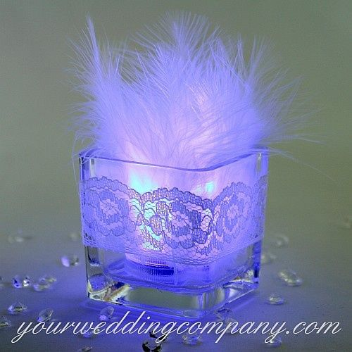 "This simple DIY votive candle includes an LED tea light candle with 3"" marabou feathers inserted..."