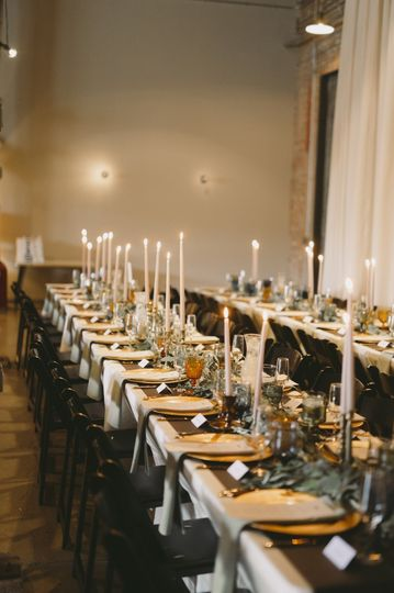 Long table setting with candle centerpiece
