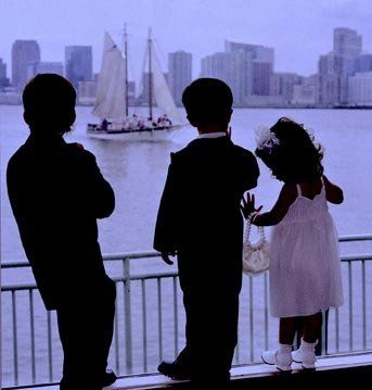 Flower girl and ring bearers watch a schooner sail by at The Lighthouse at Chelsea Piers.