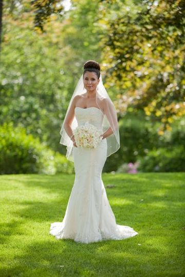 Modern strapless A-line wedding gown.  Bodice and skirt have beaded embroidery. Grounds at Castle...