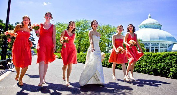 Bride and bridesmaids strut their stuff in front of the Conservatory at the New York Botanical...