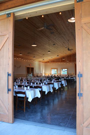 Open the authentic equestrian barn doors to enter the Blue Sage Barn reception