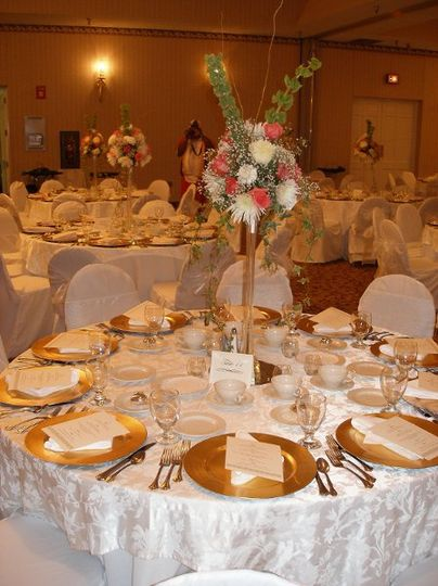 White table set-up with gold silverware