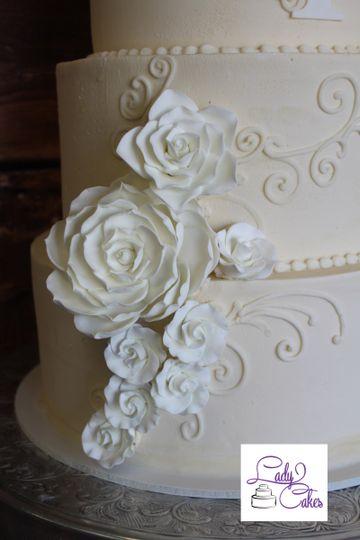 elegant wedding cake with white sugar flowers