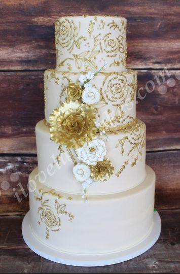 gold piped wedding cake