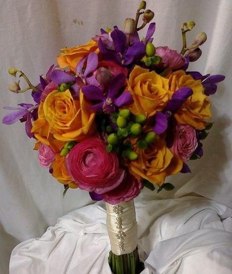 orange roses, pink ranunculus, green berries, purple orchids
