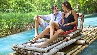 couples on bamboo rafting