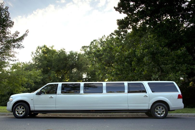 This elegant vehicle can accommodate 12-14 passengers and is a favorite among discerning brides...