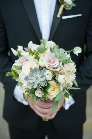Groom holding the bouquet