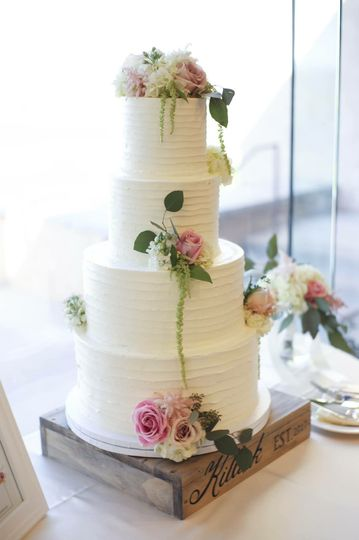 White wedding cake with minimal flower design