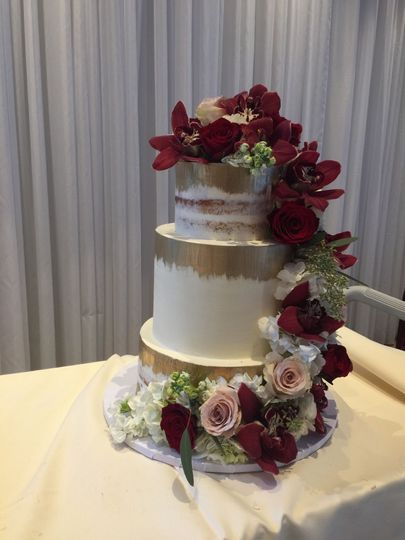 Fancy wedding cake with roses