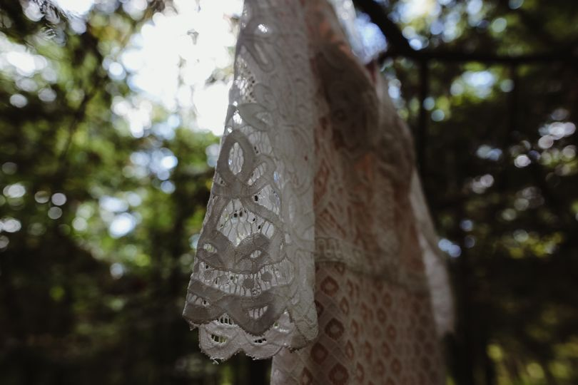 Dramatic angles of the dress in the woods