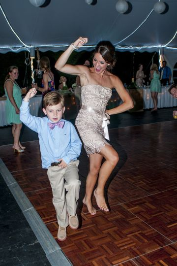 Bridesmaid and ring bearer dancing