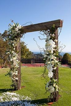 ceremony alter outdoor rustic white flowers