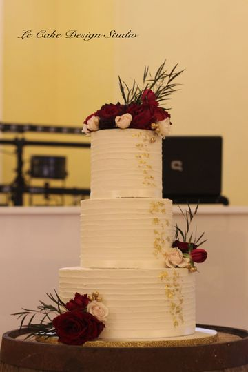Buttercream Wedding Cake Featuring Texture, Bits Of Gold & Real Flowers
