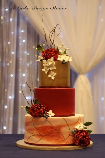 Fondant Wedding Cake Featuring Gold, Marbeling With Gold Painted Accents
