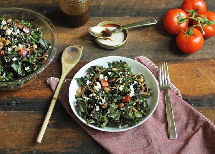 Fall inspired kale salad with goat cheese, apples, candied pecans, balsamic dressing