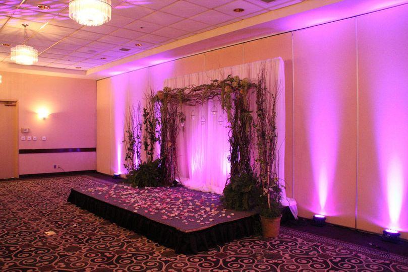Wedding arch and uplighting