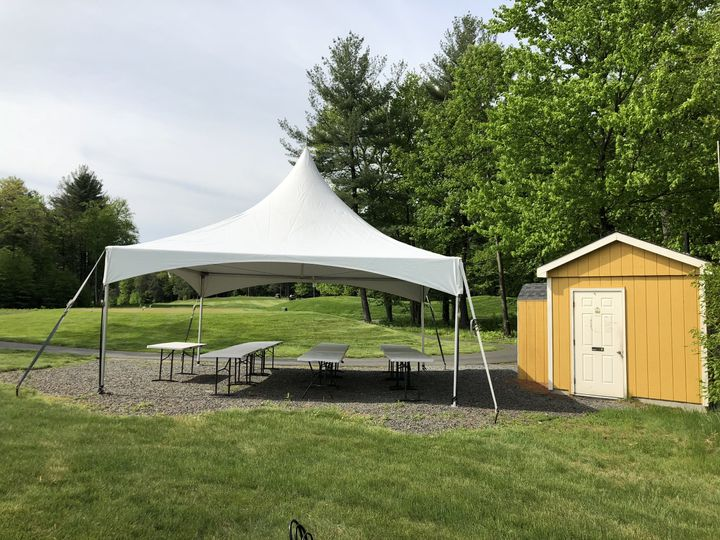 Tent set-up next to a outdoor bathroom