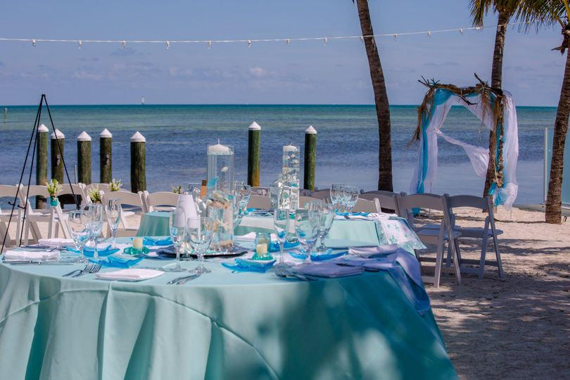 Beach wedding guest table with centerpiece