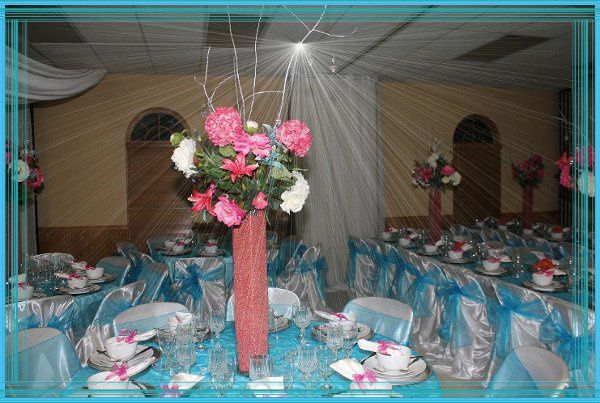 Beautiful July Wedding with ceiling draping, effects lighting, tall floral centerpieces with elegant...