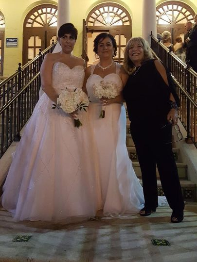 Lovely brides and officiant