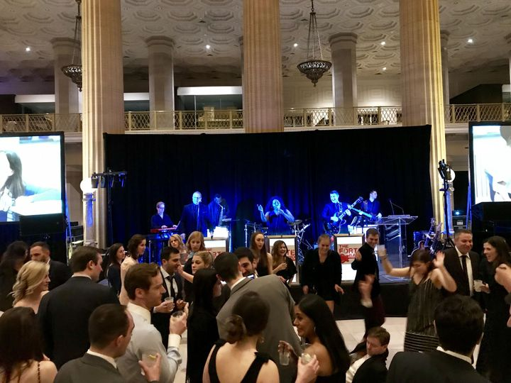 Band playing music for the reception | Venue: Wintrust Bank Building, Chicago