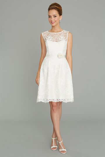 Macrame lace tops a strapless sweetheart neckline, drops to a fitted waist and then flows into a...