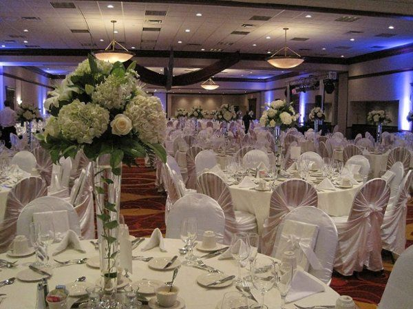 Tall centerpieces of hydrangea, roses and lilies