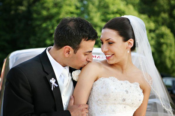 Groom gives his bride a kiss