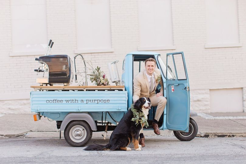 Groom with dog and Vespa