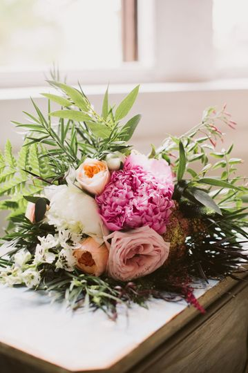 Wild Deluxe bridal bouquet with a pop of pink!