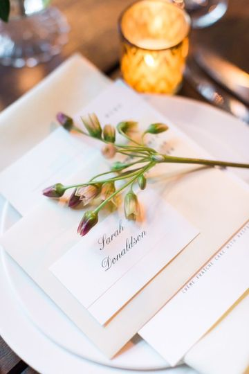 Details, details! A single bloom placed at each placesetting is an impactful detail to consider.