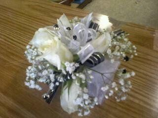 White Rose corsage with black and silver accents.
