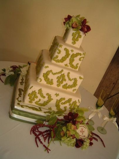 Ivory Fondant with royal icing details and fresh flowers. Inspired from a Martha Stewart Weddings...