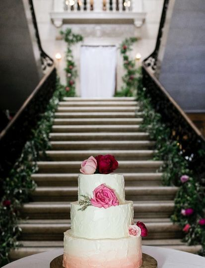 3-tier wedding cake by the stairs