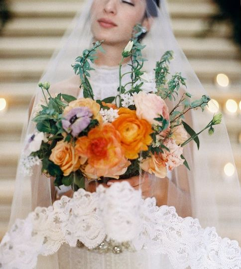 Bride in veil and her bouquet