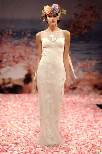 APHRODITE  Ivory beaded lace gown with blush silk lining and ribbons streaming from the...