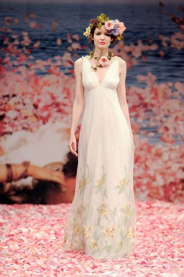 ARIA  Iridescent green embroidery over lace with pastel ribbons streaming from the embellished...