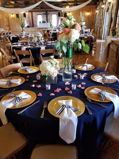 Stonehall Event CenterBlue Navy tablecloths with Ivory napkinsAnna,Texas